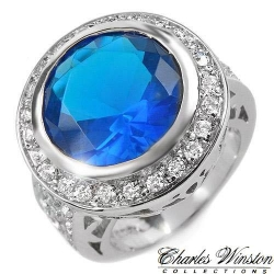 #6904 Hõbesõrmus tsirkoonidega ja sinise safiiriga
