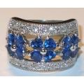 #6924 Hõbesõrmus tsirkoonidega ja siniste safiiridega